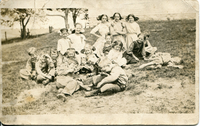 """5. This picture of some school kids from Newton. The girls in the back row  are like the modern day """"Mean Girls."""""""