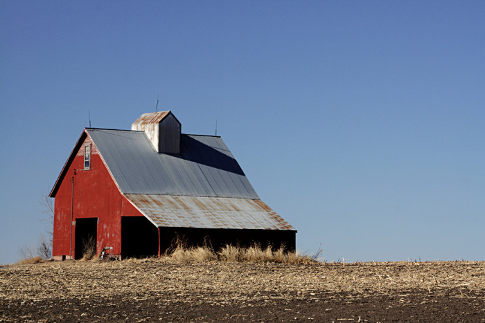 7. A Bright Red Barn Against a Clear Blue Sky