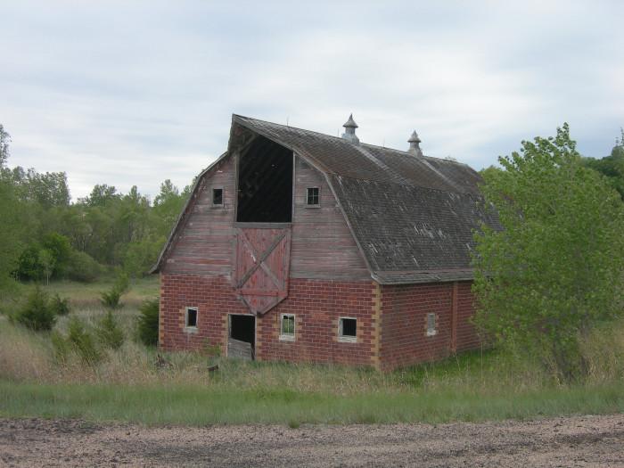 6. A Beautiful Brick and Wood Barn Near Center, NE