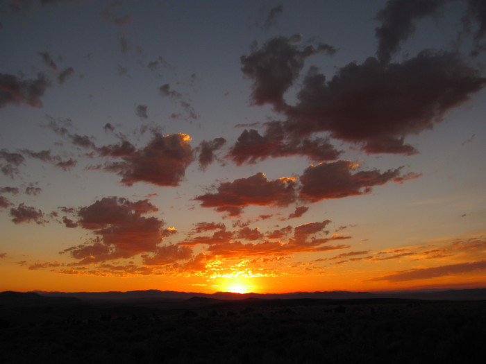 9. I love how this AMAZING sunrise over Sheep Mountain appears to be chasing the clouds away.
