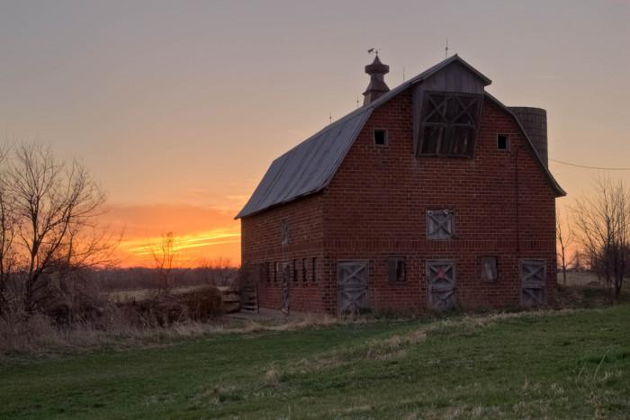 7. This gorgeous brick barn watches the sun go down near West Des Moines