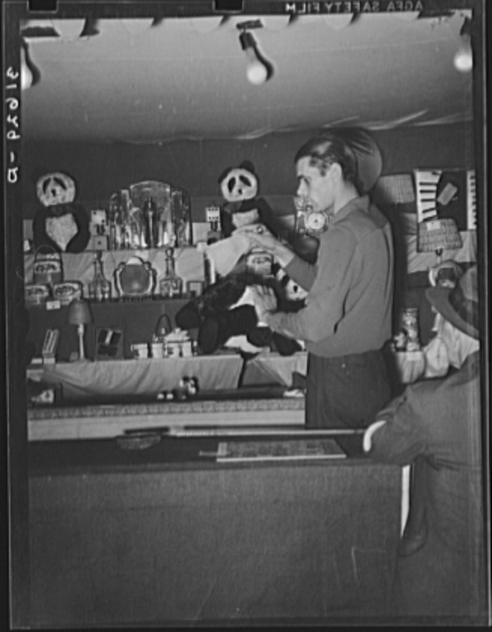11) Concessionaire Dusting off A Prize, 1938