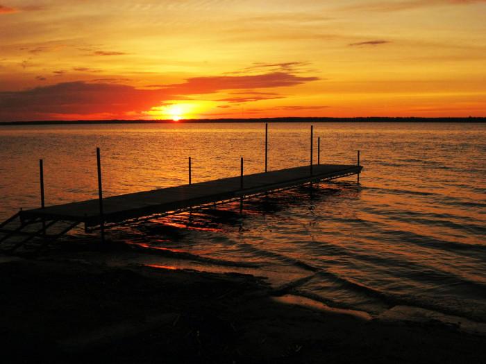 1 An orange glowing sunrise reflects across Lake Bemidji.