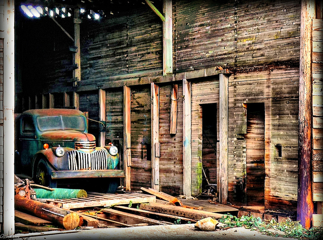11) Interior of an old barn, with a vintage truck