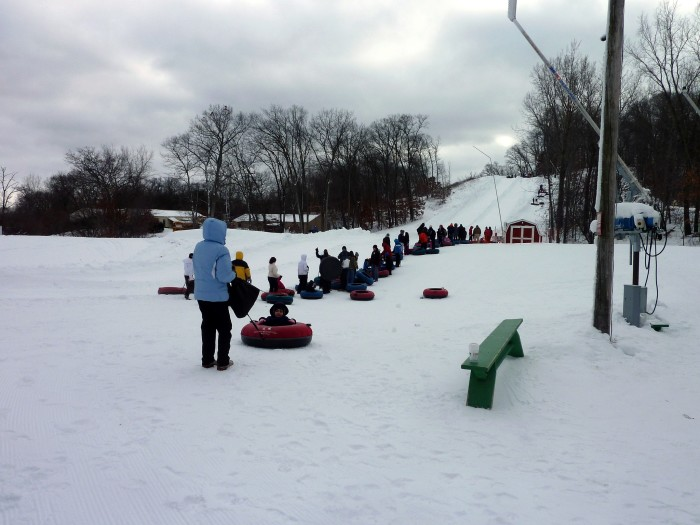 7. We love tubing on our lakes. But when it snows over, we take them out and slide down a hill!