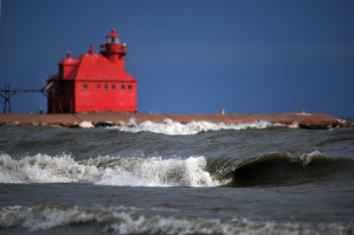 10. Great shot of this wave with the background of the Sturgeon Bay Canal Pier Lighthouse.