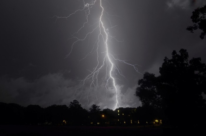 14. This lightning shooting down on Madison looks like a tear in the photo.