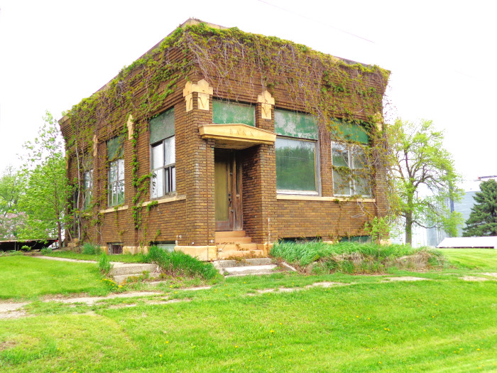 13 This old bank in Hadley, Minnesota is a vision covered in vines.