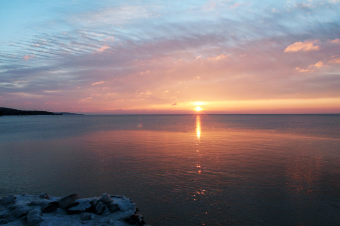 5 A slow sunrise beams across the lake in Grand Marais.