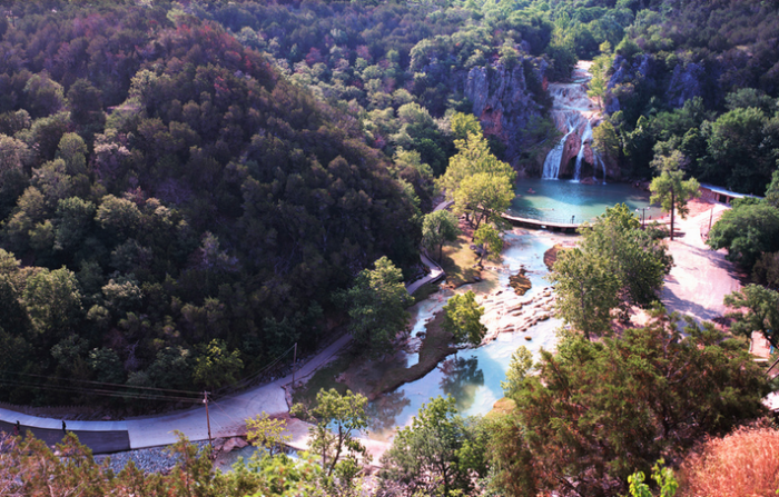 13. This photo was taken overlooking Turner Falls in the Arbuckle Mountains.  Enjoy the man-made water slides and diving boards while taking in the spectacular waterfalls.