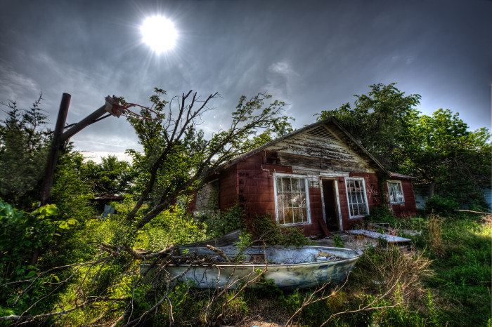 4.) Vegitation is reclaiming this old boat house in Picher, OK.