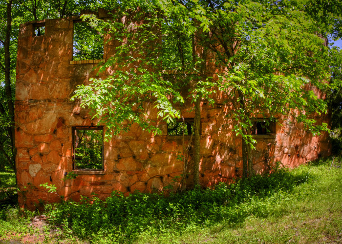 10.) Nature is growing all around this abandoned structure in Langston, OK.