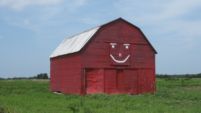 1. Located off SH 39 between Wanette and Asher, sits the red smiling barn.