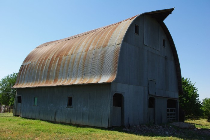9. This rounded top barn in Woods County, watches over this family farm.