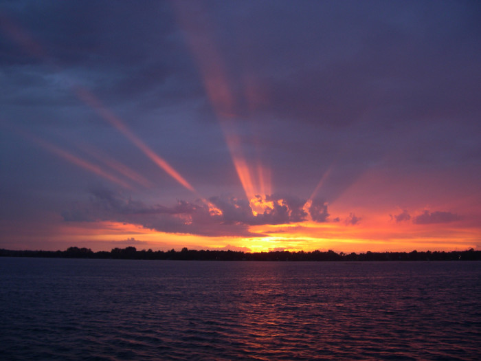 7 Brilliant rays shoot upward from Ottertail at sundown.