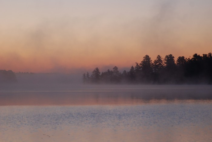 8. Great shot of a foggy sunset over the lake