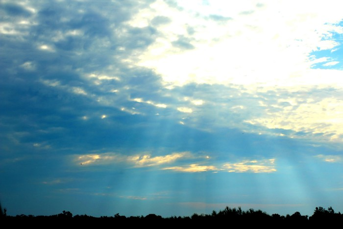 9. Awesome shot of the sun light poking through the clouds