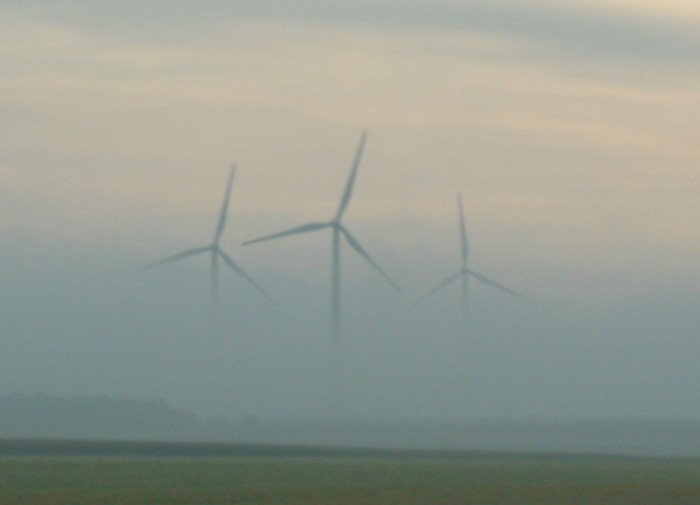 8. Awesome shot of the windmills set back in the clouds