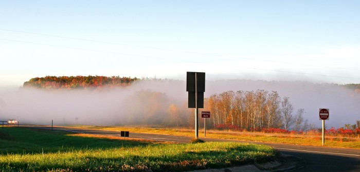 3. This highway mist with the autumn trees poking out is awesome