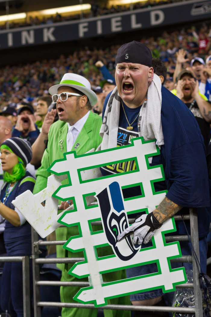 """10. They have a giant blue and green """"12"""" painted on them, beer in hand, yelling """"SEEEEEEAHAWKSSSSS!"""""""