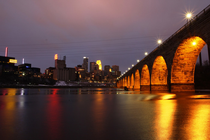 9 A treasured shot of Stone Arch Bridge gleaming in the evening sky.