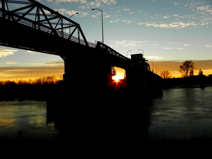 This sunset emerges through the Simpson Ave Bridge, over the Hoquiam River.