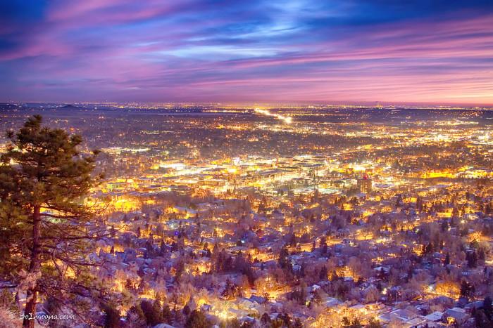 13.) Boulder lighting up the night sky