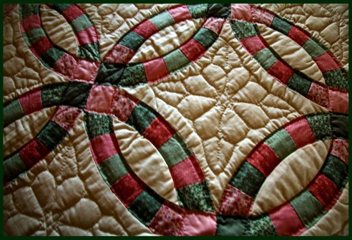 1. A homemade quilt that has most likely been passed down for generations.
