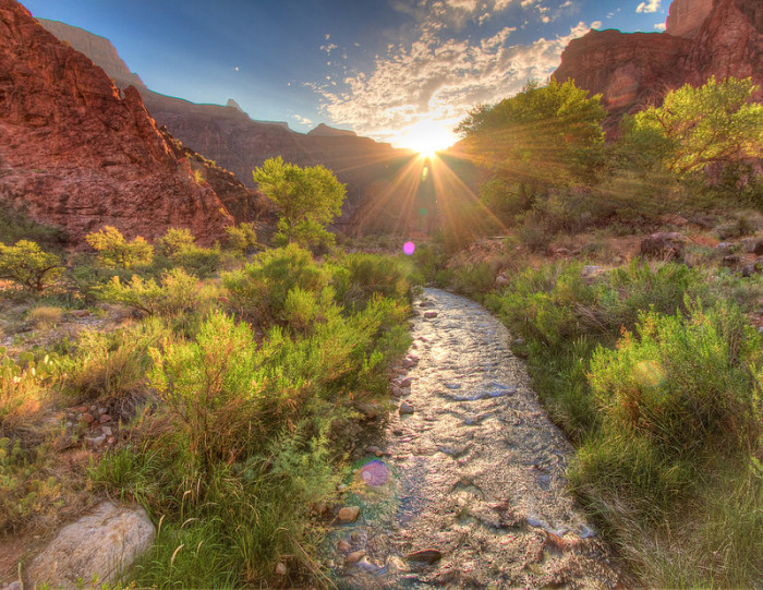 14. The sun begins to shine down in the Grand Canyon.