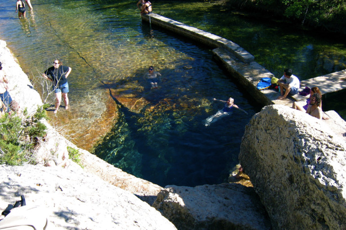 7) Head out to Jacob's Well and jump off the rocks into the 200 ft hole below!