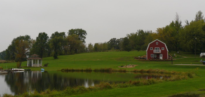 4. This is a beautiful pond and barn at a farm in Hartland, MN.