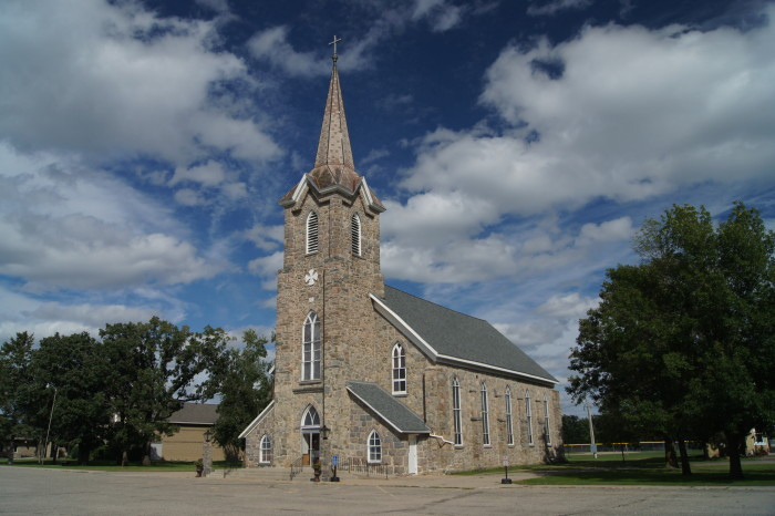 13. St. Wendelin Church in Luxemburg Minnesota looks amazing under a blanket of clouds.