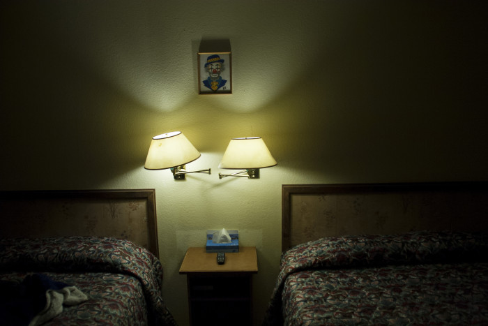 As you sleep, clowns will be staring down at you from their pictures that hang over the beds and on the side walls. Yikes!