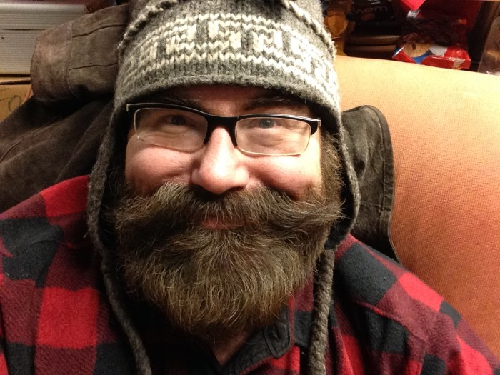 7. The men are sporting a flannel or a beard (or both).