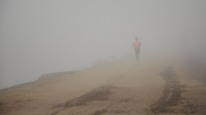 5. A jogger runs during an unusually foggy winter morning in Phoenix.