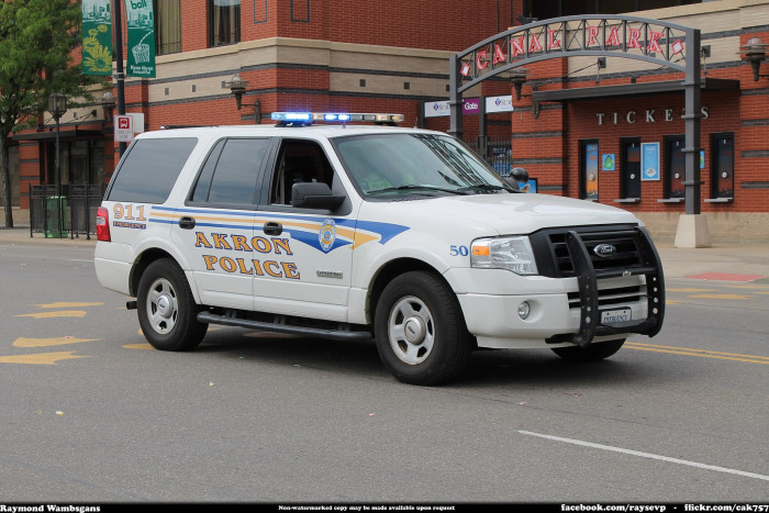 8) Akron was the first city to use police cars.