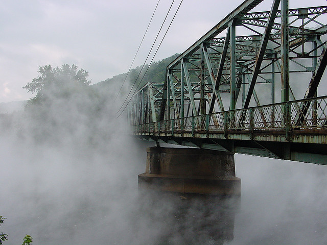 10. The fog wraps itself around this bridge in Clearfield.