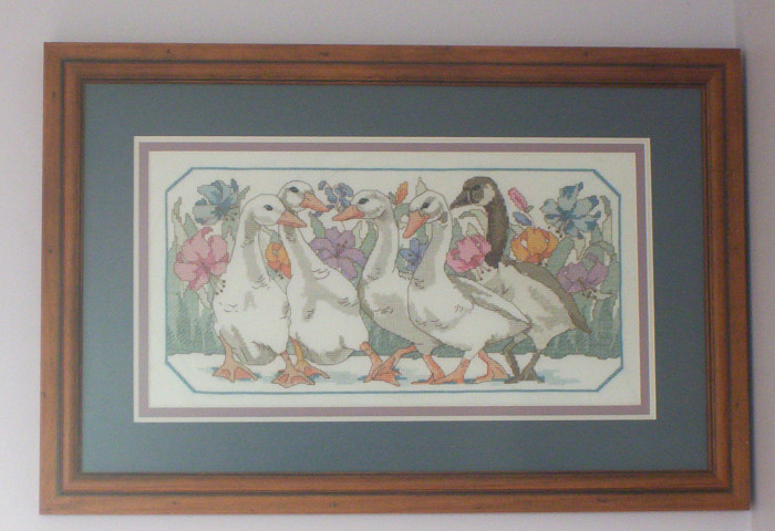 2. Some type of framed cross-stitch that was made by a family member.