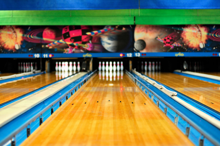9. Score a strike at the alley.