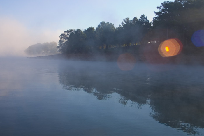 16) Misty view of Lake Hartwell with rays of sunshine bouncing off the surface of the lake.