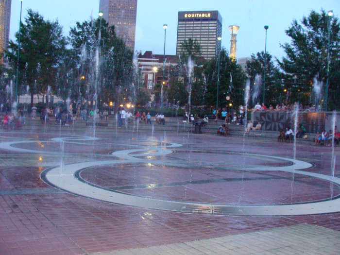 8) Take your kids to Centennial Park in Atlanta and let them run around in the sprinklers