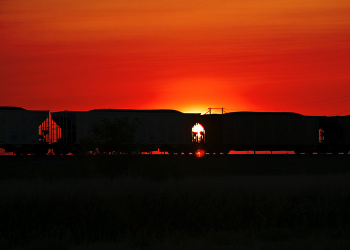 Simply Beautiful: A Train Rolling in Front of a Fiery Sunset