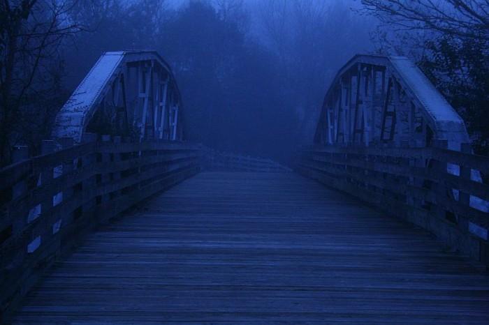 14) A foggy moonlit bridge awaits you in Alvin, Texas.