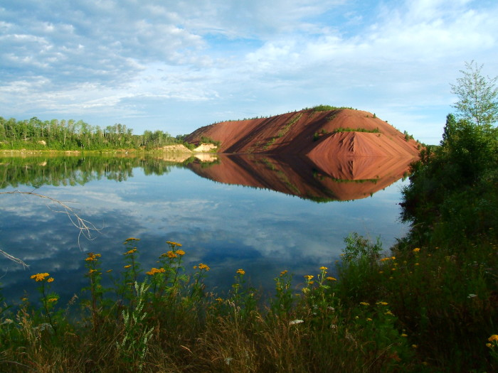 Now - Filled with water in many parts, the Mesabi Iron Range provides these scenic lakes.