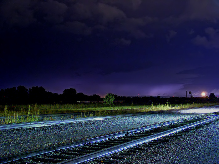 3) A late night storm rolls in over Waco, lighting the sky in a foreboding, ghostly purple glow.