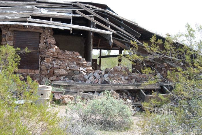 14. This building at Vulture Mine is slowly finding its way back to the ground.
