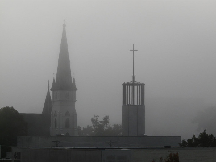 Lincoln landmarks poke up out of a pea soup fog.
