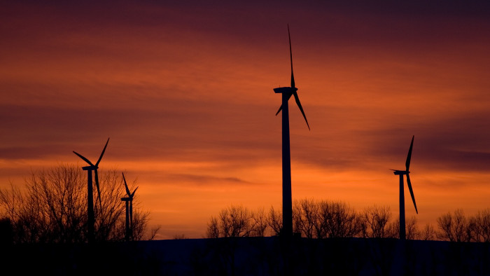 22. The sunset behind a wind turbine farm is glorious.