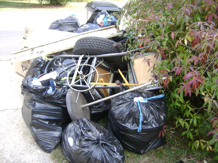 4. In Minnetonka, it is a public nuisance to pile, store or keep old machinery, junk, furniture, household furnishings, appliances, component parts, or other debris. Keep it tidy people.