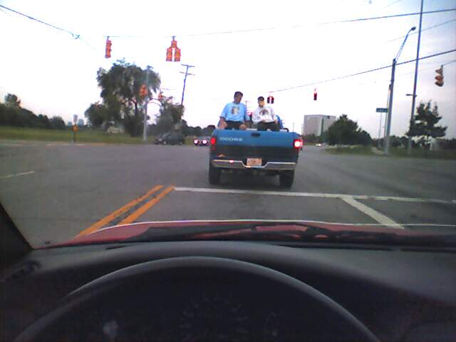 10) What you can't see very well is that these gentlemen are sitting in lawn chairs:
